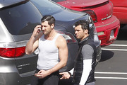 """Exclusive: The dancers of hit TV series """"Dancing with the Stars"""" congregated in the parking lot for a chat after a rehearsal at a local studio in Los Angeles, California on February 28, 2012. Pictured: Tony Dovolani with Maksim Chmerkovskiy"""