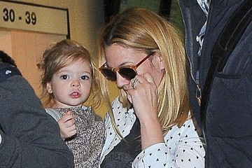 Drew Barrymore Drew Barrymore & Daughter Olive Arriving On A Flight At LAX