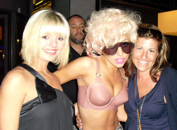 A very drunk Lady Gaga poses with fans in the Sofitel Hotel lobby for