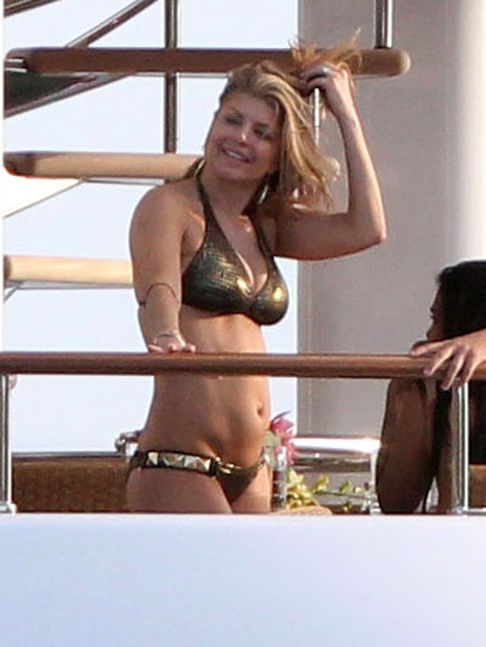 With her voluptuous body and Regular blond hairtype without bra (cup size 36C) on the beach in bikini