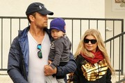 """Couple Fergie and Josh Duhamel take their son Axl out for breakfast in Brentwood, California on December 20, 2014. Fergie recently expressed an interest in expanding their family saying """"We definitely want another one,"""" Fergie admitted. """"But there are no plans anytime in the near future."""""""