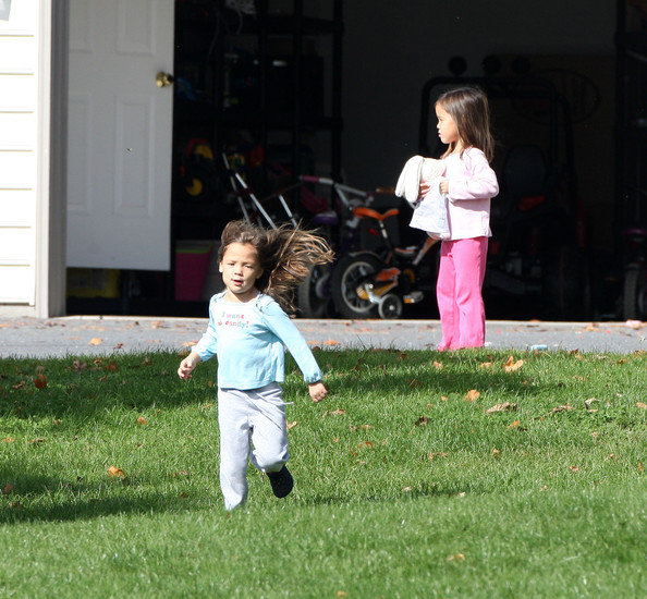 Children playing outside in a nursery