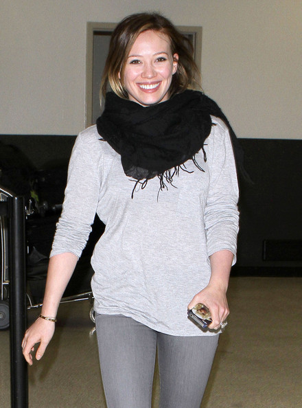 Hilary Duff Actress Hilary Duff sharing some laughs with the waiting paparazzi after arriving on a flight at LAX airport in Los Angeles, CA. Hilary posted on her Twitter page...I'm in the USA!!! About to get some puppylove! And see my fam. Btw nicest paps at lax. Very funny.