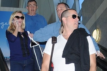 Jim Toth Reese Witherspoon and Her Family Arrive on a Flight at LAX