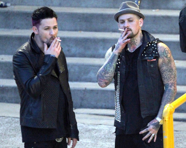 Benji Madden smoking a cigarette (or weed)