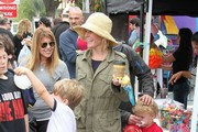 'Modern Family' actress Julie Bowen and husband Scott Phillips take their sons Oliver, John and Gustav shopping at a Farmers Market on Easter Sunday in Studio City, California on March 31, 2013.
