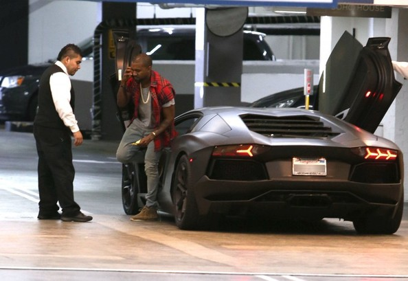 Kanye West Rapper Kanye West driving his Lamborghini to a business meeting in Beverly Hills, California on October 12, 2013.