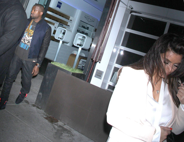 Kanye West Kim Kardashian and Kanye West trying to avoid being photographed while out in New York City, New York on April 5, 2012.