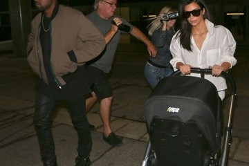 Kanye West Kim Kardashian and Kanye West Land at LAX
