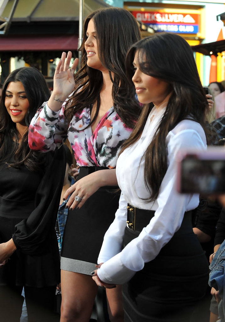 The kardashian girls at the grove to do an interview on for What does kourtney kardashian do