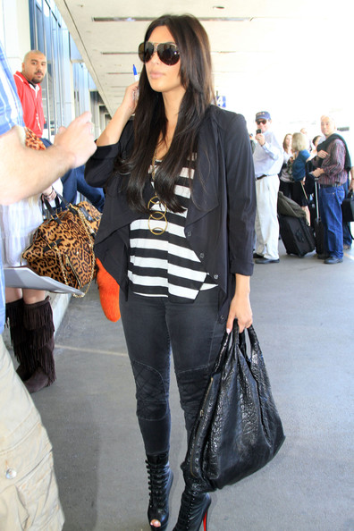 Kim, Kourtney and Khloe Kardashian arriving for a flight at LAX airport in Los Angeles, CA.