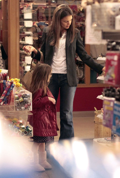 Katie Holmes Actress Katie Holmes takes her daughter Suri to the Granville Island Kids Market to shop for toys in Vancouver, Canada. Suri is seen waving a Canadian Flag and playing with a train set.