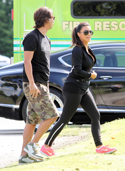 Kim Kardashian The Kardashian family was seen at a park doing stretches and practicing their rowing skills before heading out on boats in Miami, Florida on September 29, 2012.