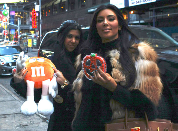 Kim Kardashian and Kourtney Kardashian seen leaving the Legacy Recording Studios and receiving a gift from the M&M store from a paparazzi in New York City, NY.