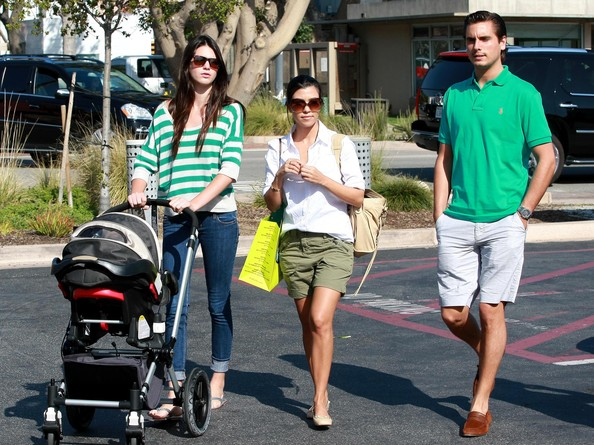 Kendall Jenner Socialite Kourtney Kardashian, her sister Kendall Kardashian, Scott Disick and their son Mason Disick out shopping at the Malibu Country Mart in Malibu, CA.