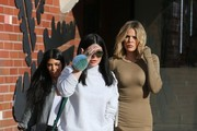Kourtney and Khloe Kardashian go to lunch with their sister Kylie Jenner at 'Health Nut' in Woodland Hills while filming 'Keeping Up With The Kardashians' on January 22, 2016. Kourtney arranged for Kylie's car to be covered in balloons to surprise Kylie. The balloons even had pictures of her face on them.