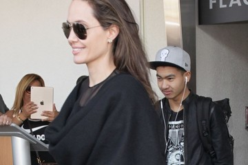 Maddox Jolie-Pitt Angelina Jolie and Her Children Arrive at LAX Airport