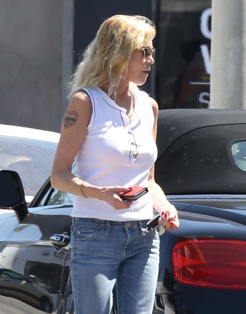 Melanie griffith photos photos melanie griffith at a for Melanie griffith tattoo