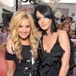 She hangs out on the red carpet with Katy Perry.