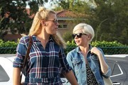 Actress Michelle Williams and Busy Philipps hold hands while they shop in Beverly Hills, California on November 15, 2016.