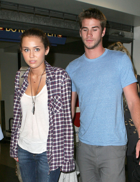Miley Cyrus 06-16-10 Los Angeles, CA Singer/actress Miley Cyrus and her boyfriend Liam Hemsworth hold hands as they arrive at LAX to catch a late night flight to Toronto. Miley is set to host the 2010 Much Music Video Awards.
