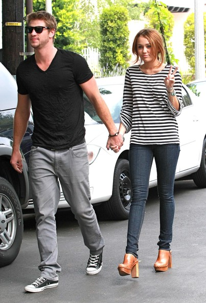 Actress Miley Cyrus and her boyfriend Liam Hemsworth spotted out and about in Toluca Lake, CA.