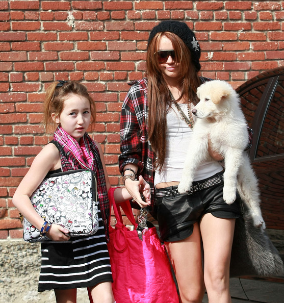 Actress Miley Cyrus and her sister Noah arrive at a studio in Burbank with her little dog too.