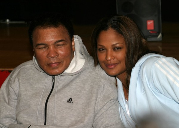 PHOTO:Laila Ali poses with her father, Muhammad Ali, after her 10 round