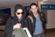 Neve Campbell and JJ Feild at LAX