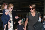 'Before I Go To Sleep' star Nicole Kidman, her husband Keith Urban and their daughters Sunday and Faith arrive on a flight at LAX Airport on July 2, 2014 in Los Angeles, California. The couple returned from Australia where Urban serenaded his wife with a song during his concert to mark their eight year anniversary!