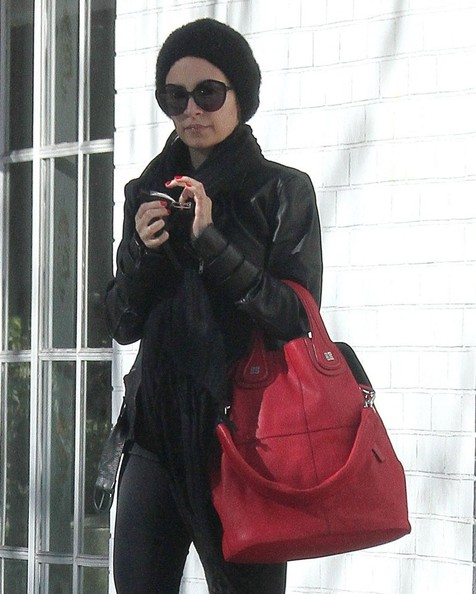 Socialite Nicole Richie tries to cover her face after leaving a gym in Studio City, California on December 20, 2012.