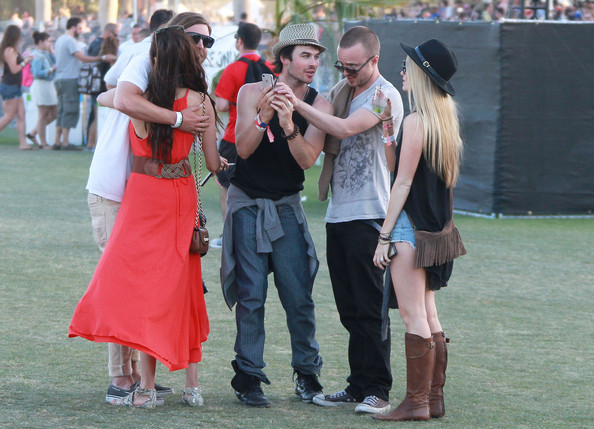 "Nina Dobrev Celebrities gallivant around the grass areas of the ""Coachella Music Festival? on day 3 of the massive event located in the Coachella dessert of California on April 15, 2012."