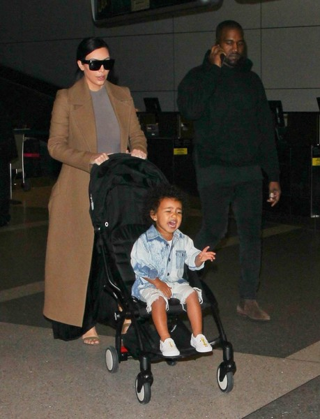Kim & Kanye Touch Down At LAX