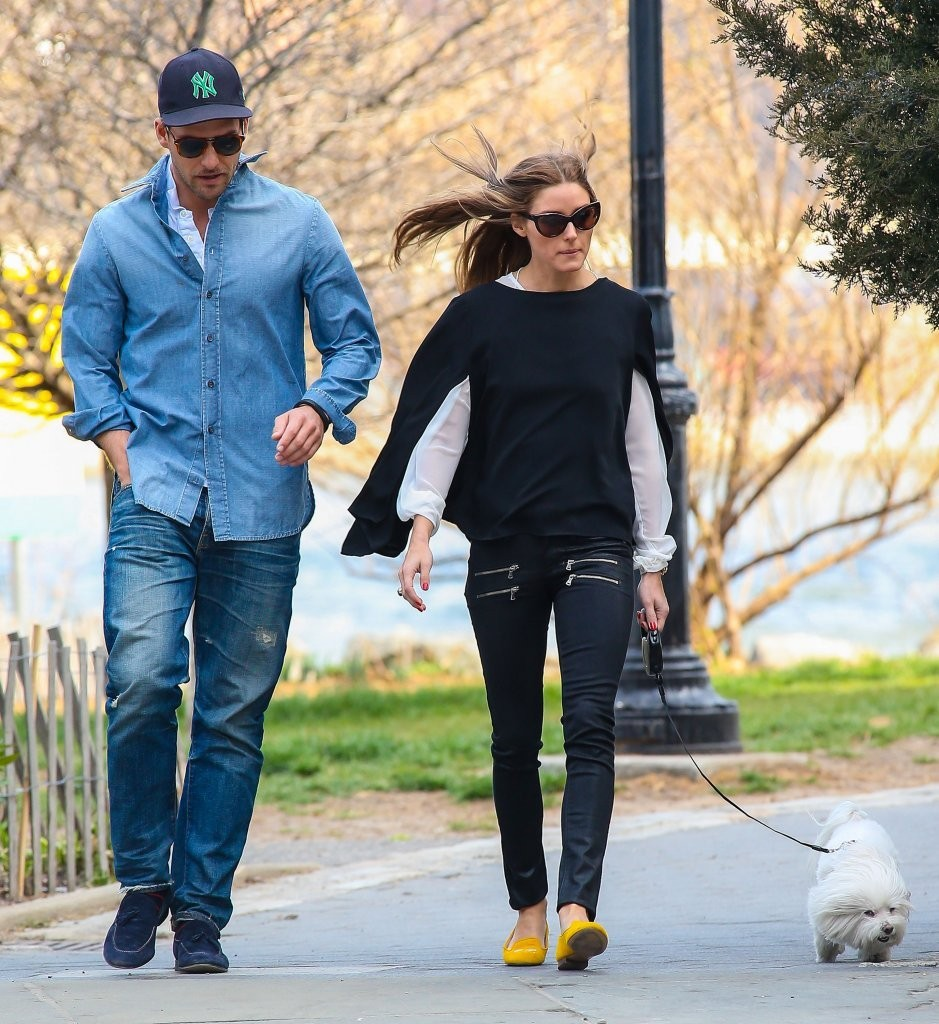 Socialite Olivia Palermo and her boyfriend Johannes Huebl walk their dog in New York City, New York on April 9, 2013.