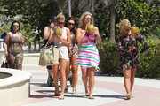 The stars of the ?Only Way is Essex? looked to be enjoying their vacation in Miami, Florida on March 22, 2012. The ladies playfully posed for the cameras as they headed back to their local hotel after a day out. Pictured here is Lauren Goodger wearing a multicolored jumper with long brown hair and Frankie Essex in a pink, green, blue and white stripped dress with long hair as they walk with their girlfriends. <br />