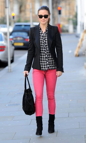 Pippa Middleton Dressed in electric pink stained jeans, Pippa Middleton brightens the day while heading into work on January 11, 2012 in London, UK.