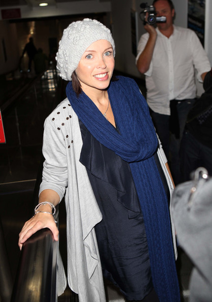 Pregnant singer Dannii Minogue arrives at the Melbourne airport.