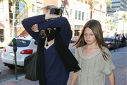 Actress Rebecca De Mornay hiding her face from the cameras while out with her daughter Veronica O'Neal in Beverly Hills, California on March 21, 2012