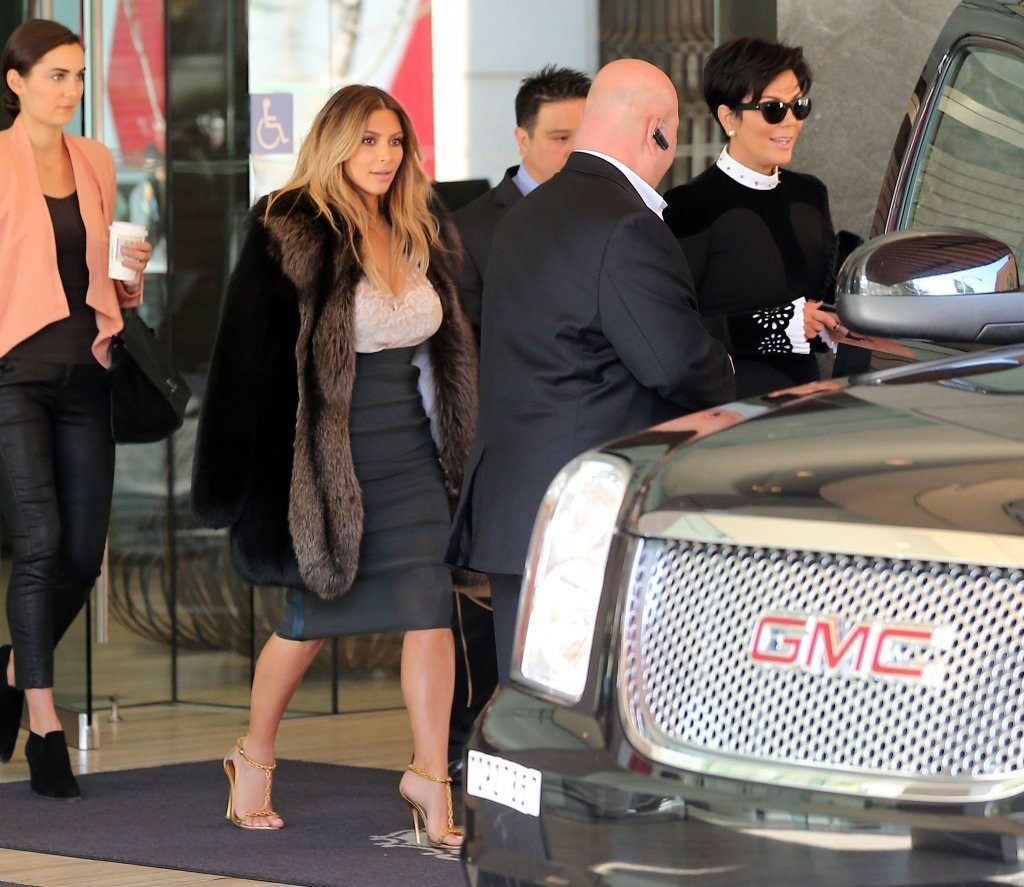 Recently engaged reality star Kim Kardashian spotted leaving her hotel in San Francisco, California with her mom Kris Jenner on October 22, 2013. Kim's husband to be rapper Kanye West popped the question on Monday, Kardashian's 33rd birthday.