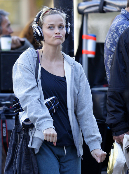 "Actress Reese Witherspoon lets loose and boogies down to some music on her headphones on the set of ""This Means War"" in Vancouver, Canada."