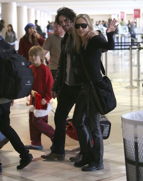 Sharon Stone And Family Departing On A Flight At LAX