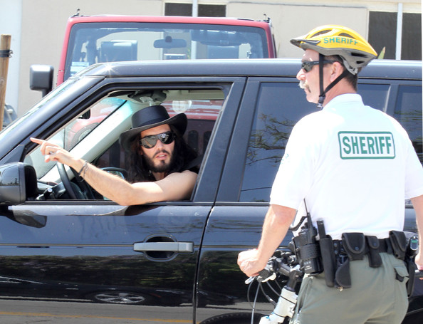Officer Pull Over : Russell brand pulled over by a bike cop zimbio