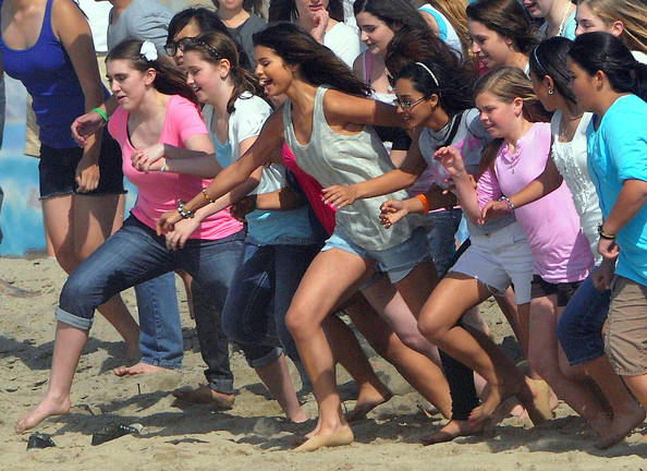 Selena Gomez Singer/actress Selena Gomez and a bunch of her fans filming a music video on Dockweiler Beach in Los Angeles, CA.