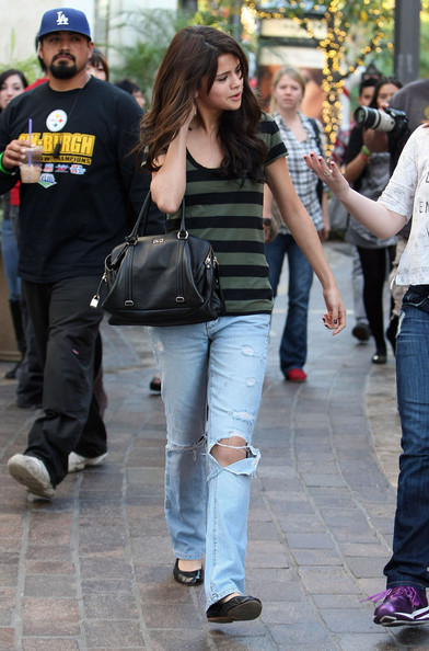 Selena Gomez Actress Selena Gomez and a friend out shopping at The Grove in Los Angeles, CA.