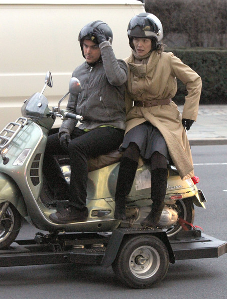 "Zac Efron, Michelle Pfeiffer and Garry Marshall on the set of  ""New Years Eve"" in New York City, NY. Zac and Michelle are riding on a moped together."