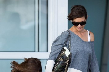 Suri Cruise Katie Holmes and Suri at the Airport