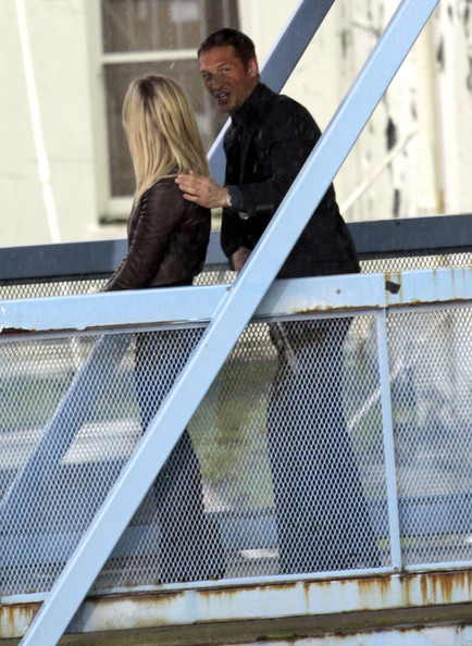 Actor Tom Hardy flirting with Reese Witherspoon in between takes on the set of 'This Means War' in Vancouver, Canada. Tom was putting his hand on her back and playing with her hair. Also on set was actor Chris Pine.
