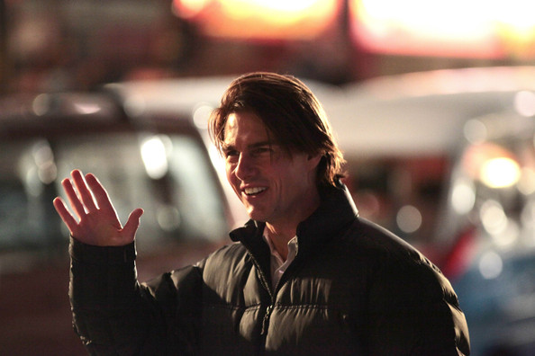 Actor Tom Cruise has a laugh with wife Katie Holmes as she pays him a visit on the set of Mission Impossible 4 Ghost Protocol.  Tom was all smiles when Katie arrived and the couple seemed to get along great with each other as well as cast and crew