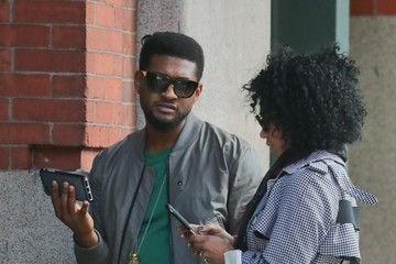 Usher Usher and His Wife Wait Outside a Building in NYC