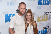 Former NHL player Valeri Bure (L) and actress Candace Cameron-Bure attend KIIS FM's Wango Tango 2016 at StubHub Center on May 14, 2016 in Carson, California.